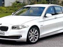 bmw_5_series_2010_f10_front_side_view
